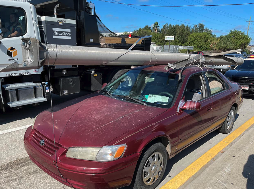 Florida Man with power pole on his car - 2