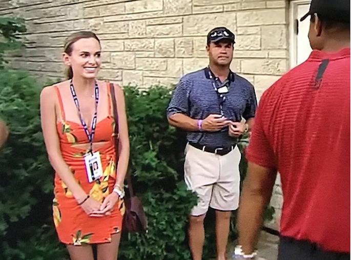 Jena Sims looking at Tiger Woods