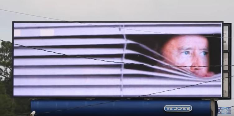 Joe Biden hiding blinds Wilmington North Carolina digital billboard