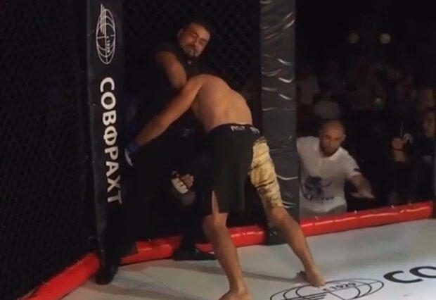 MMA ref chokes fighter