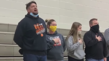 Man sings national anthem before basketball game sound system out