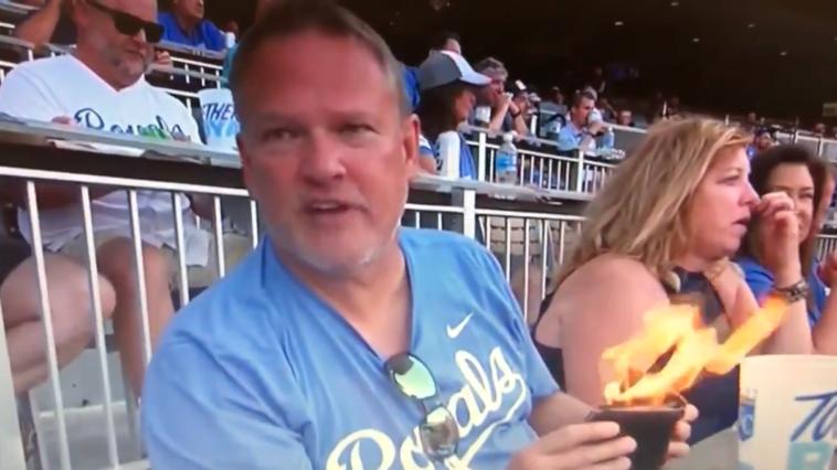 Royals fan flaming wallet