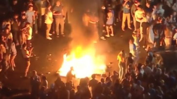 UCLA fans burn couches