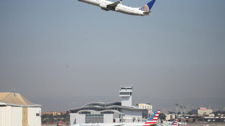 Idiot Jumps Out Of Plane On Taxiway At LAX